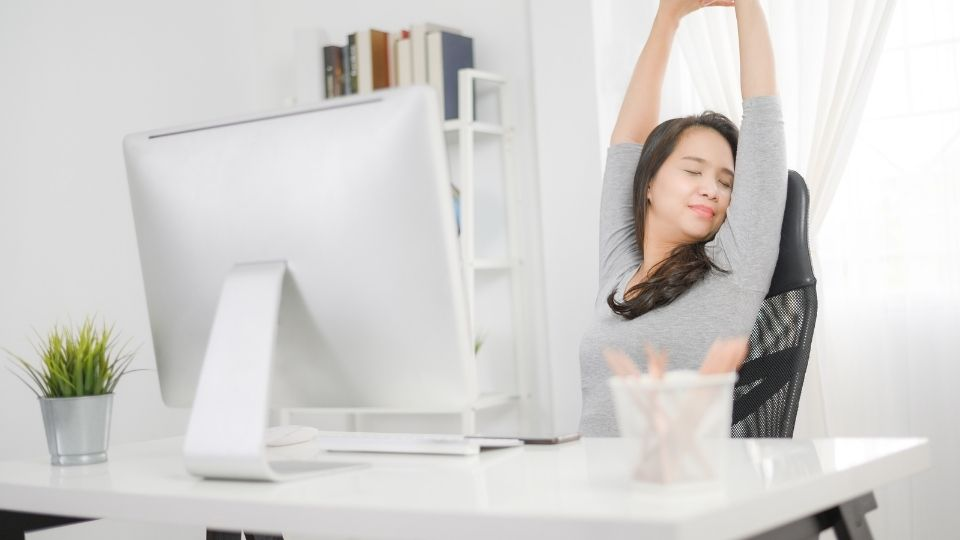 Woman sitting comfortably at on her office chair
