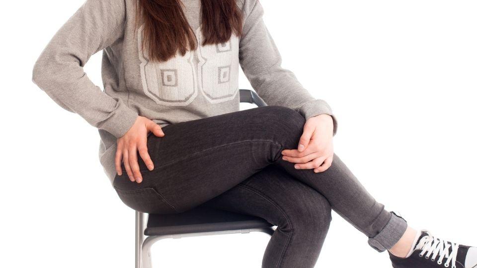 crossing legs on chair girl