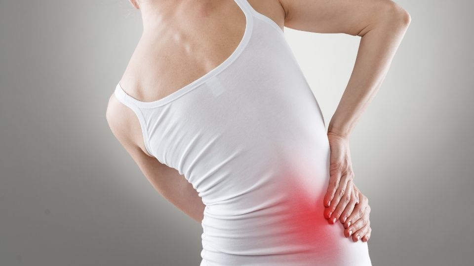 young woman with hip pain one side