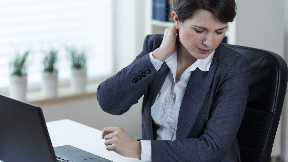 Woman Neck Pain from Desk Arrangement