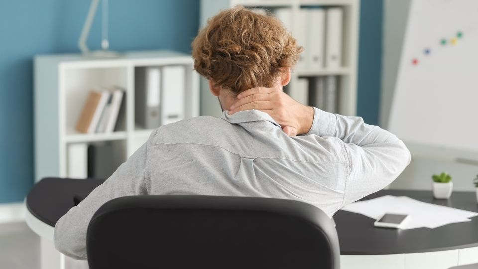 man experiencing Neck Pain from Office Chair