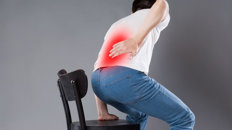 man sciatica sitting office chair