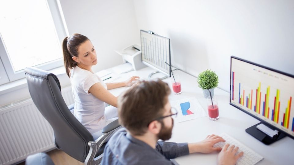 two people working at a workstation
