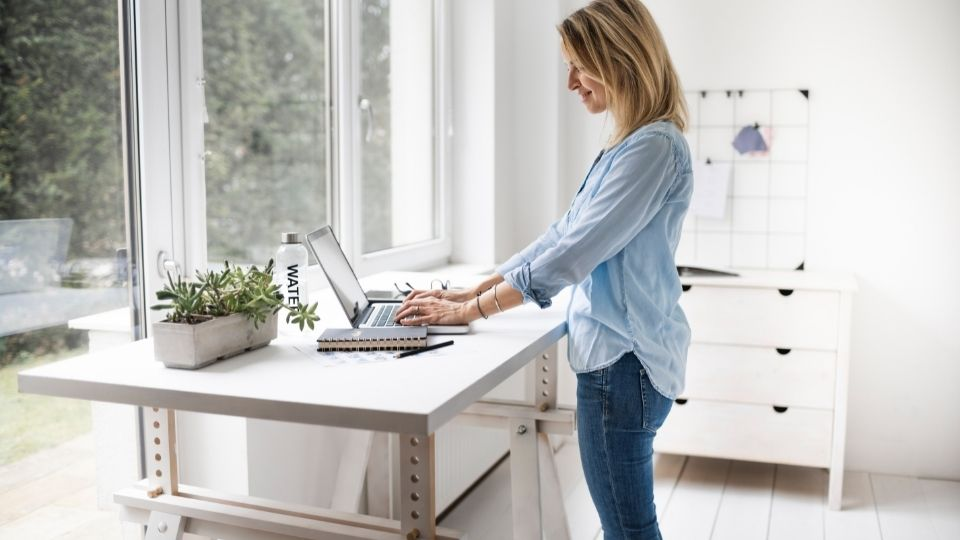 young woman at standing desk