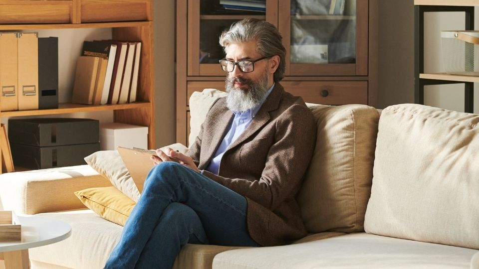 man reading on comfortable chair