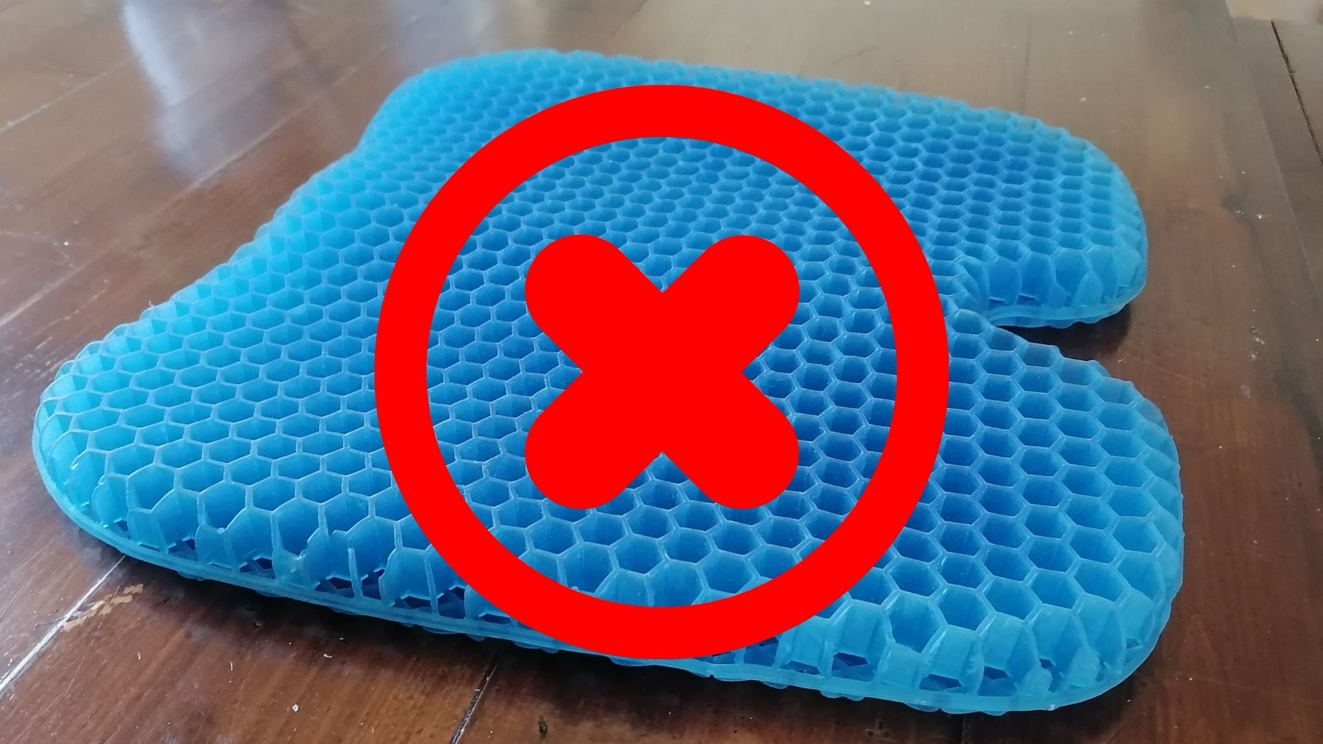 gel seat cushion with red cross on top of it
