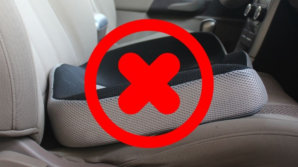 memory foam seat cushion with red cross on top of it