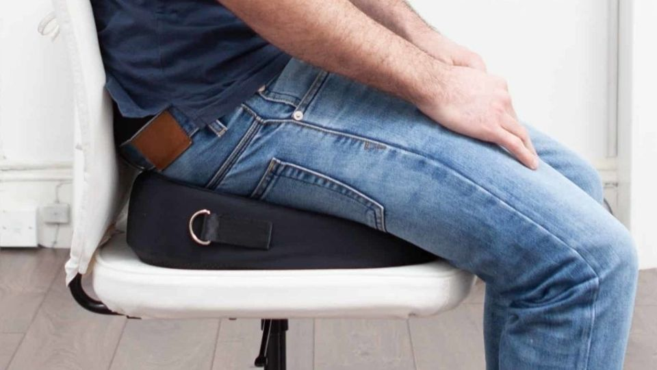 man sitting on posture wedge