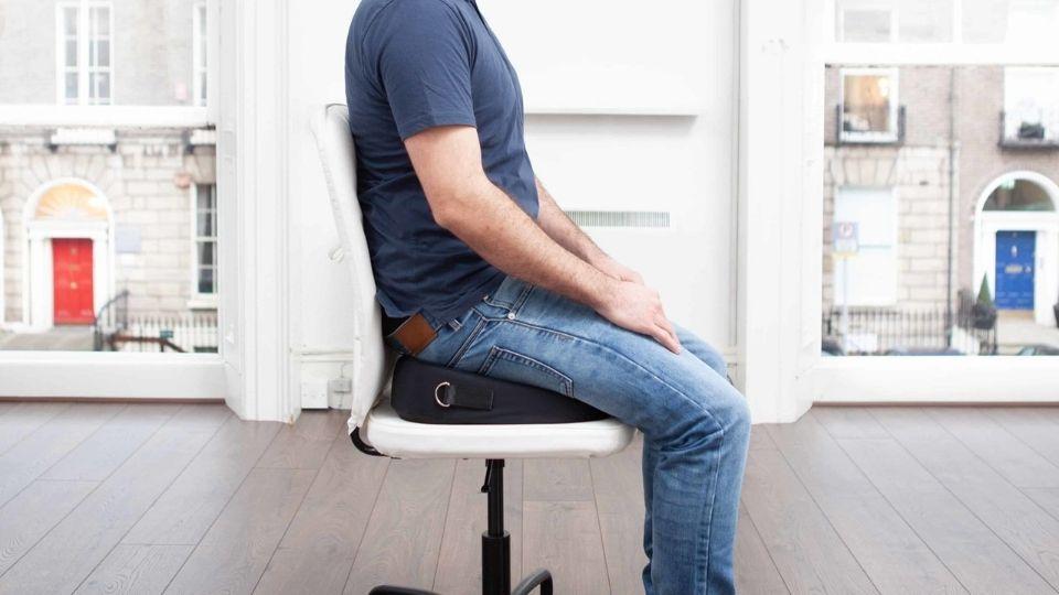 man sitting on a seat cushion
