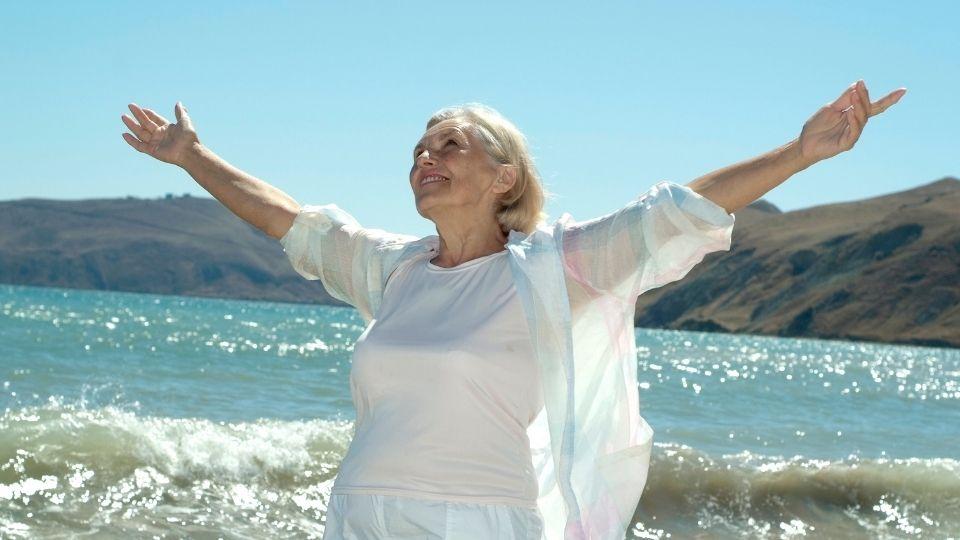woman happy on beach