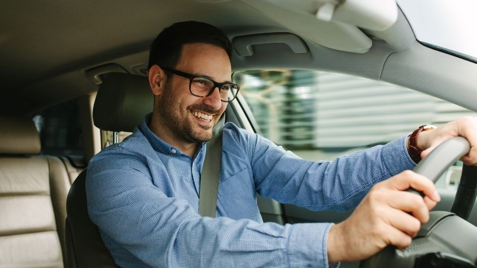 man driving car with lumbar cushion