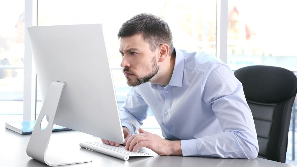 man working at office with poor posture