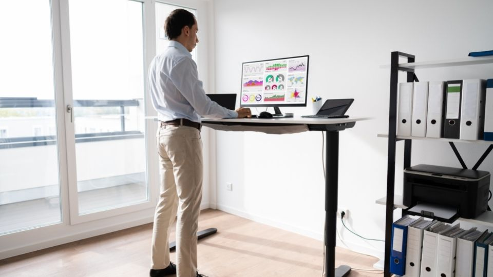 man standing at desk working