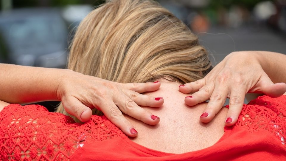 woman with stiff and sore neck