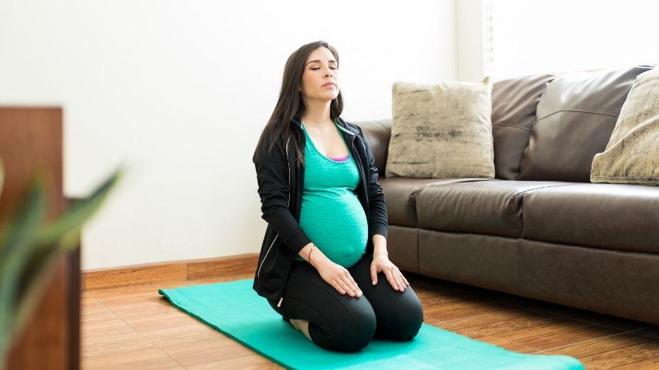 pregnant woman heel sitting