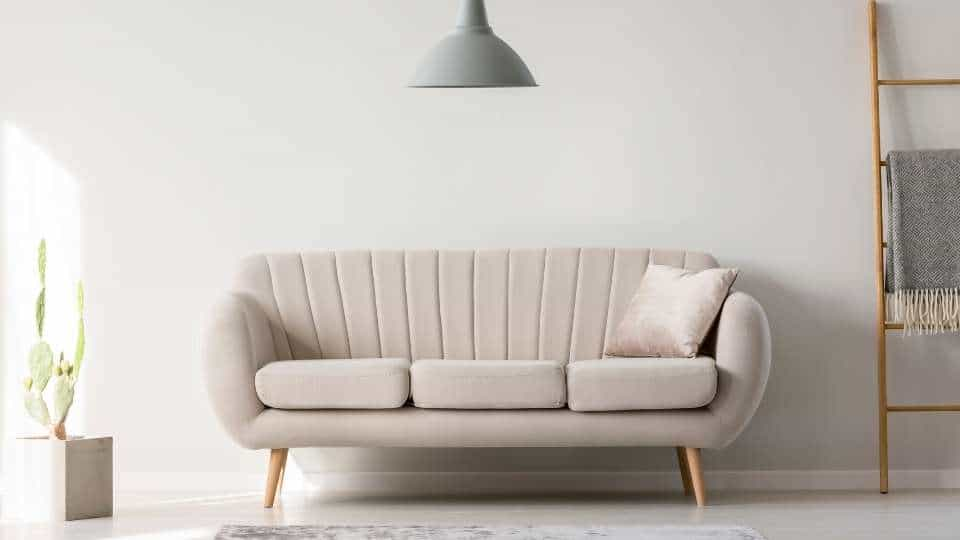 white couch in a white room
