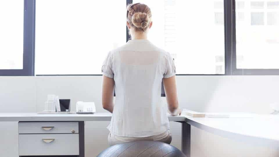 woman sitting on a exercise ball